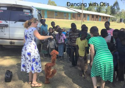 Dancing with puppet named Otis
