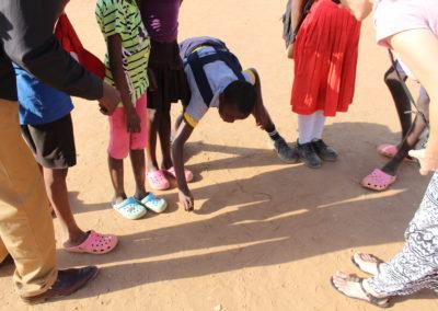 Marianne teaching Swahili in the dirt
